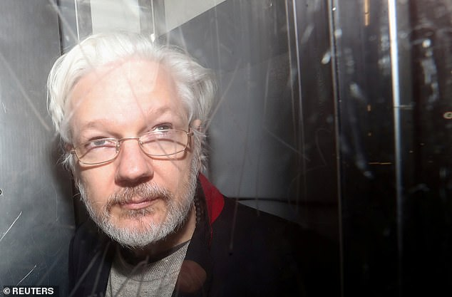 By then intimate footage of Max's birth, shot on a GoPro camera by a friend, had been seized by the US along with Assange's legal documents from his quarters inside the embassy. Pictured: Assange in a prison van as he leaves Westminster Magistrates Court in January