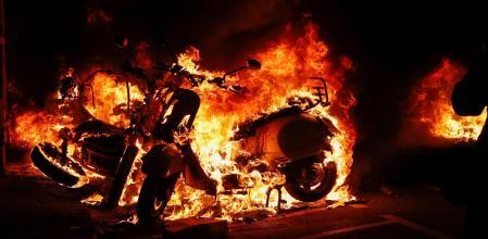 A motorbike burns during a protest against the arrest of Catalan rapper Pablo Hasel in Barcelona, Spain, February 17, 2021. REUTERS/Albert Gea