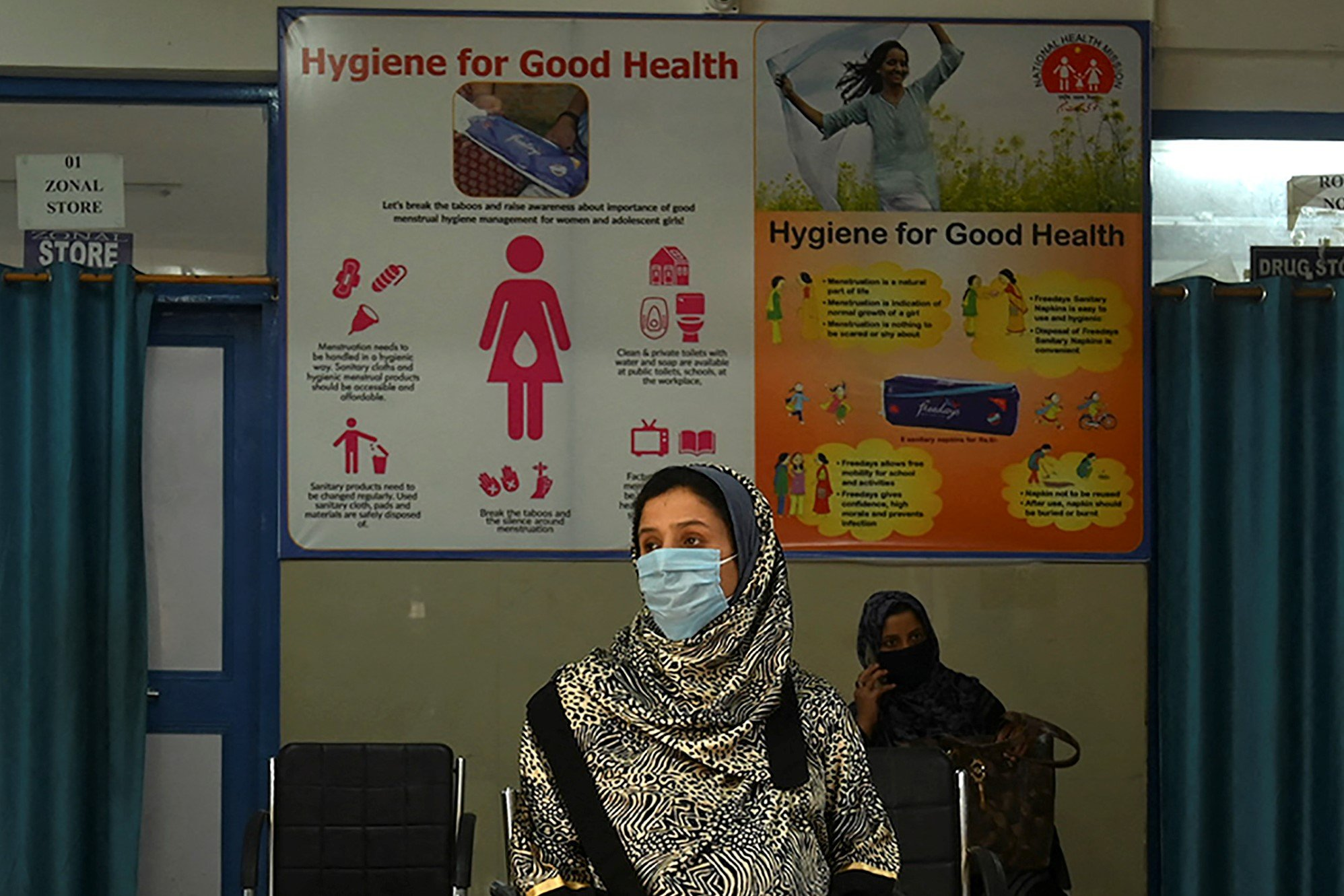 Pregnant women maintain social distancing wait for their turn at a COVID-19 coronavirus testing centre during a government-imposed nationwide lockdown as a preventive measure against the COVID-19 coronavirus, in Srinagar on May 9, 2020